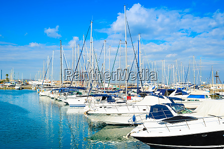 white yachts motorboats marina cyprus