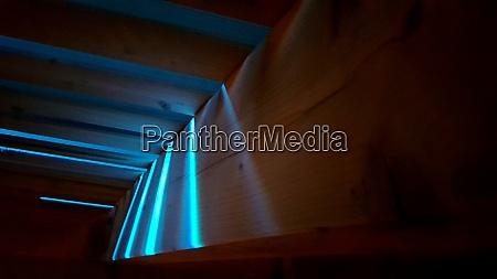 blue light trough wooden deck at