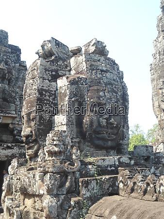 angkor wat cambodia stone faces smiling