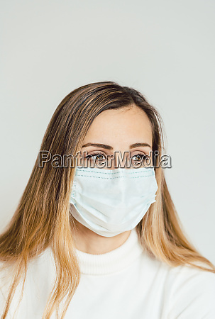 anxious woman with face mask worried