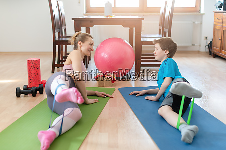 family doing sport exercises at home