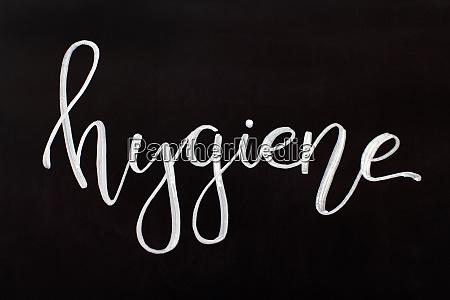 chalk inscription hygiene on a black