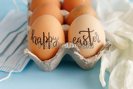 gloves facemask and eggs with inscription