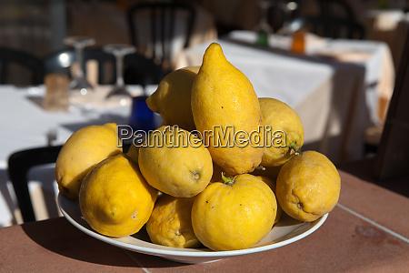 a, plate, of, ripe, lemons - 28258721