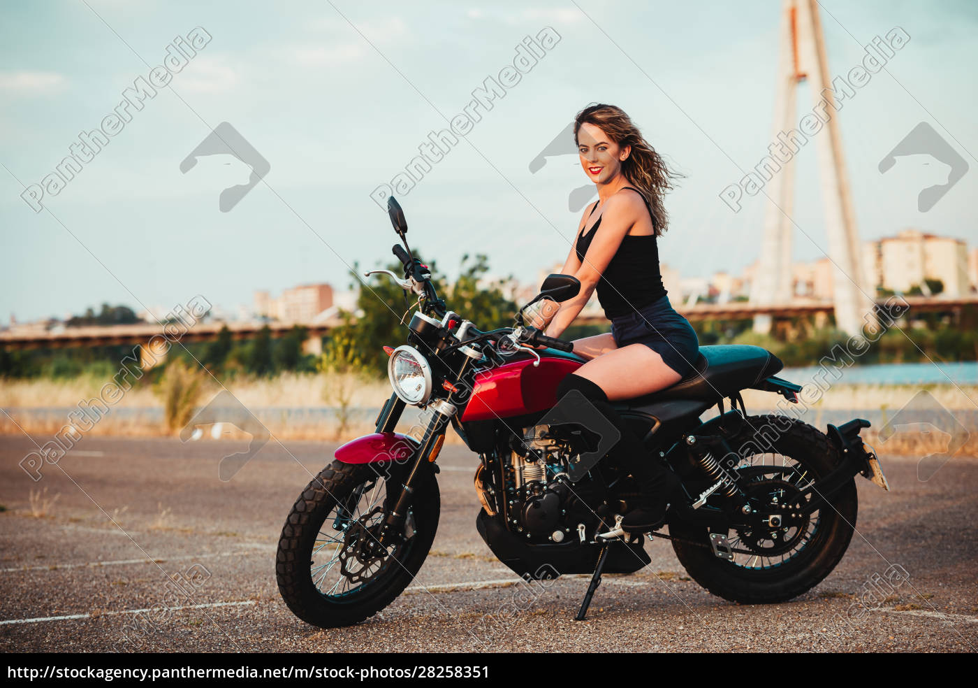 beautiful, young, woman, riding, on, a - 28258351
