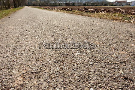field, path, with, tar, and, stones - 28258362