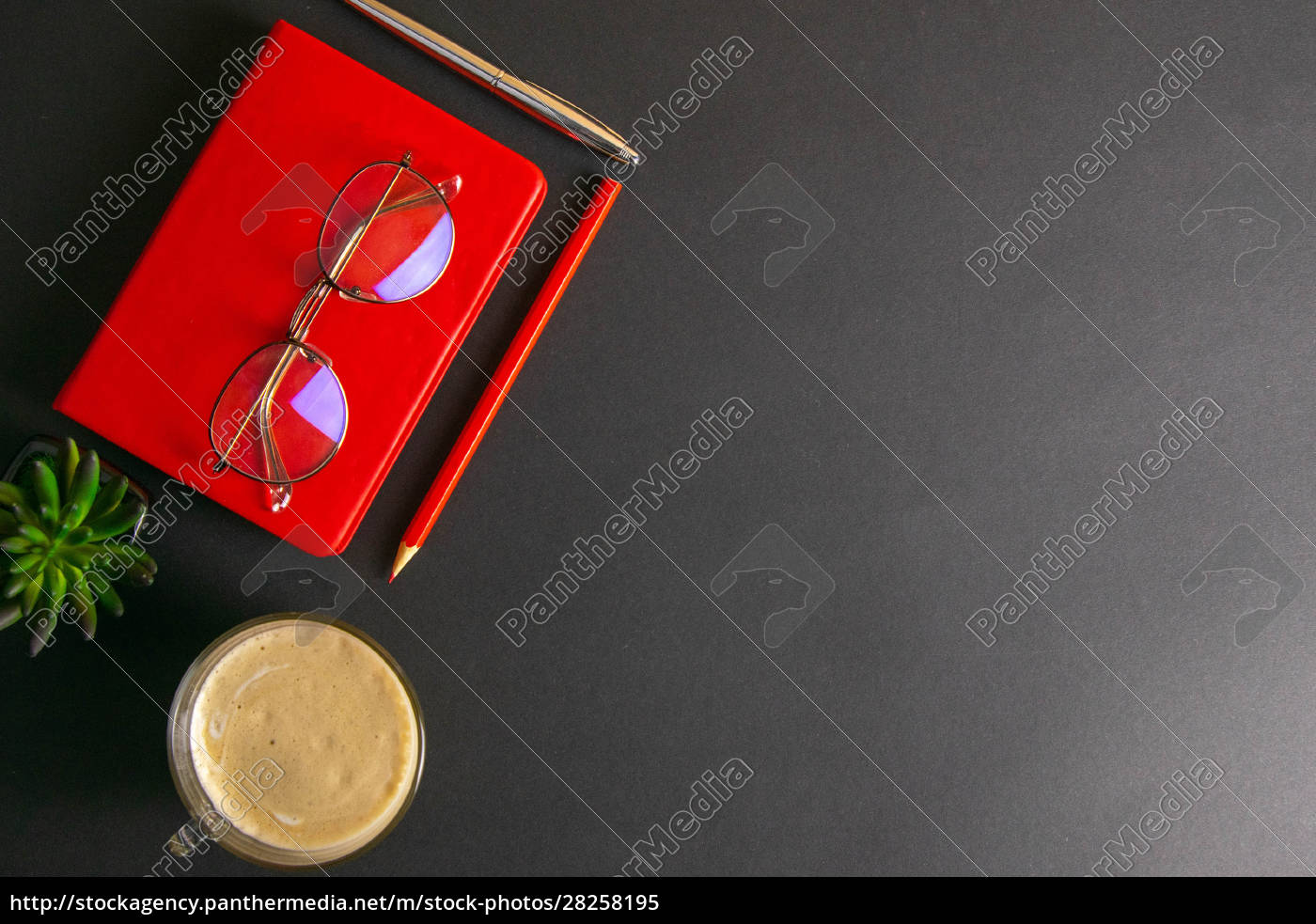 the, red, notebook, stands, on, a - 28258195