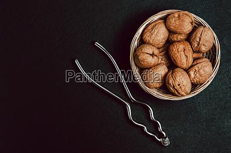 walnuts, with, nutcracker, on, black, background, - 28258349
