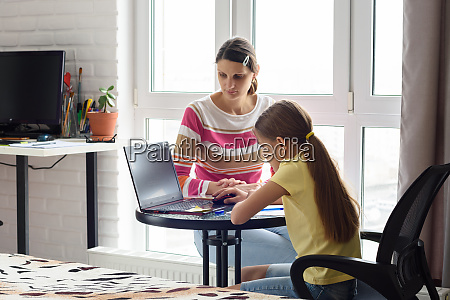 tutor educates a child online