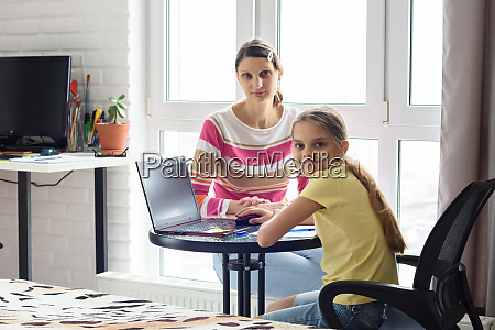 the tutor is teaching the child