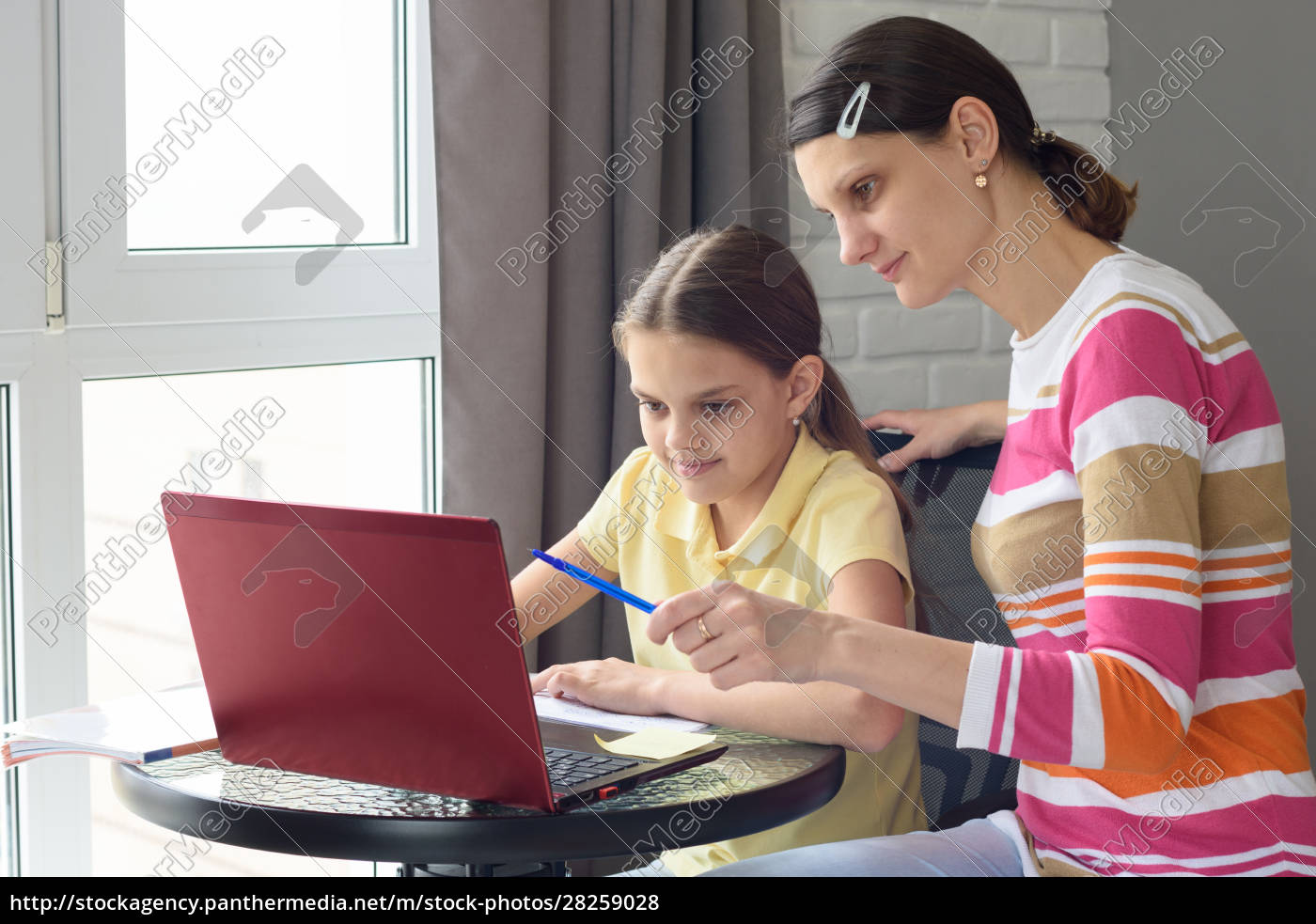 a, tutor, helps, a, girl, learn - 28259028