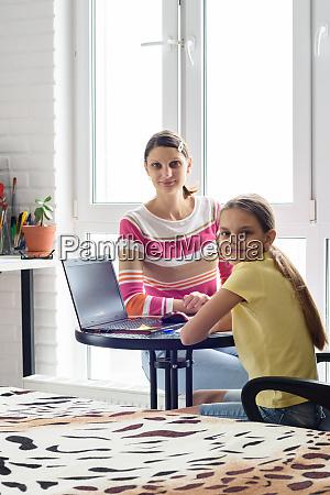 a, tutor, teaches, a, girl, at - 28259026