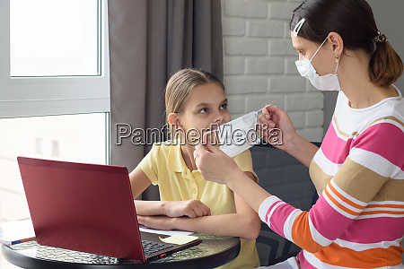 girl, at, home, puts, on, protective - 28259030