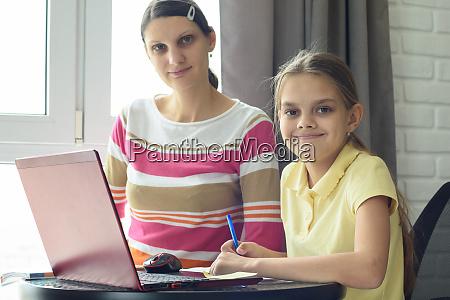 happy, girl, doing, homework, with, mom - 28259132