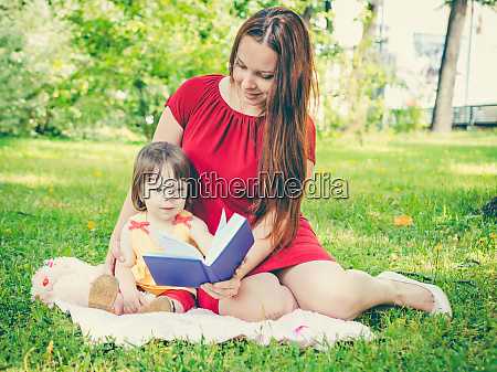 mother, and, daughter, reading, book, outdoors - 28259707