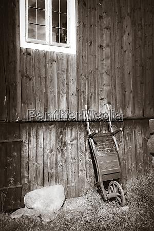 old, wooden, wheelbarrow, on, a, farm - 28259672