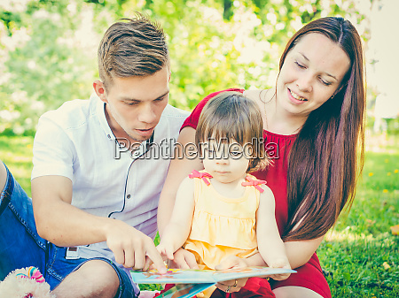 parents, and, daughter, reading, book, outdoors - 28259708