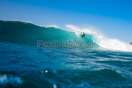 surfer, riding, waves, on, the, island - 28259506