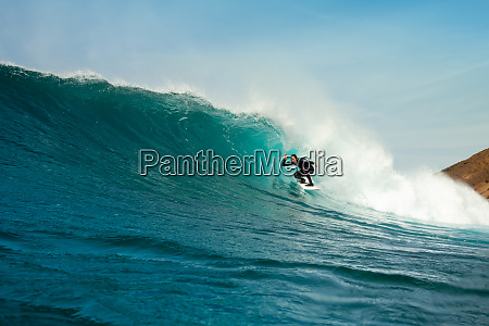 surfer, riding, waves, on, the, island - 28259528