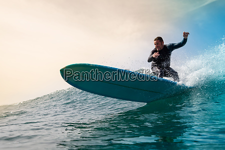 surfer, riding, waves, on, the, island - 28259530