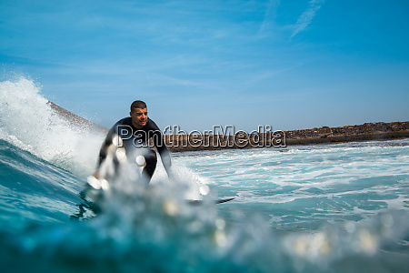 surfer, riding, waves, on, the, island - 28259552