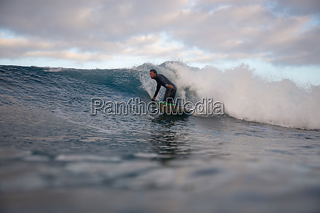 surfer, riding, waves, on, the, island - 28259579