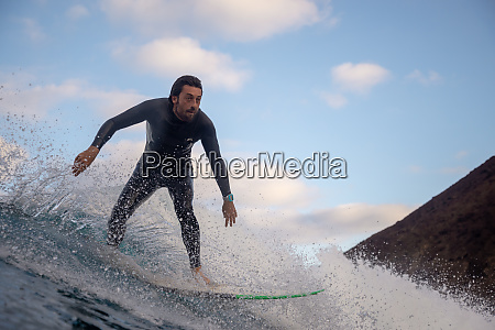surfer, riding, waves, on, the, island - 28259581