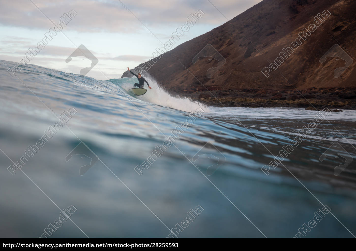 surfer, riding, waves, on, the, island - 28259593