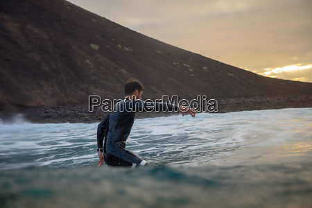 surfer, riding, waves, on, the, island - 28259594