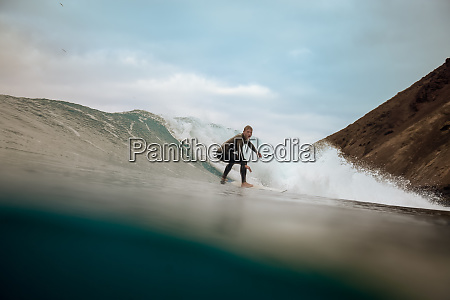 surfer, riding, waves, on, the, island - 28259597