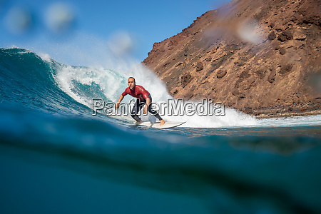surfer, riding, waves, on, the, island - 28259619