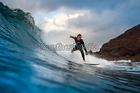 surfer, riding, waves, on, the, island - 28259622
