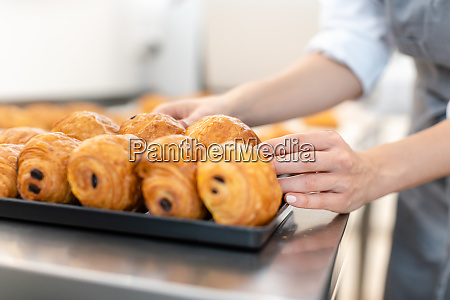 pastry chef baking pain au chocolate