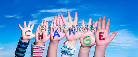 children hands building word change blue