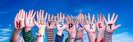 children hands building word hilfspaket means