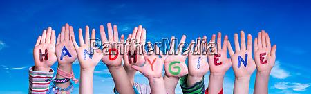 kids hands holding word handhygiene means
