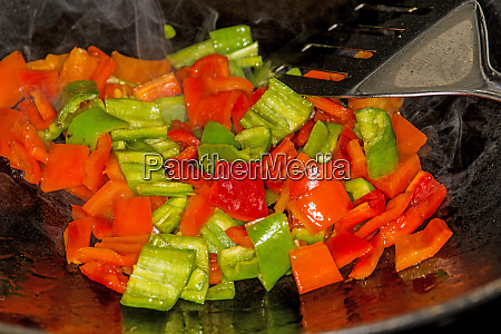 red and green cut peppers in