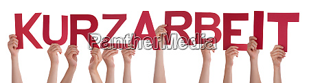 people hands holding word kurzarbeit means