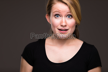 surpriseawe young woman being genuinely