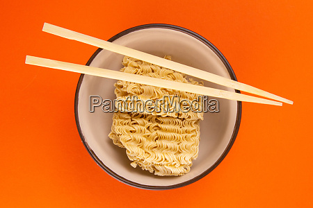 instant noodles with wood sticks asian