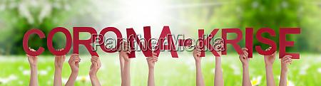people hands holding word corona krise