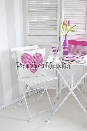 white interior with heart pillow