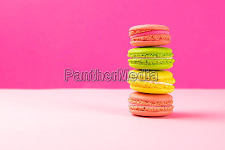 multi colored macaroons stand in a