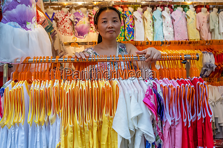 female clothes seller in her shop