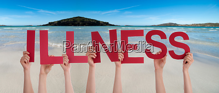 people hands holding word illness ocean