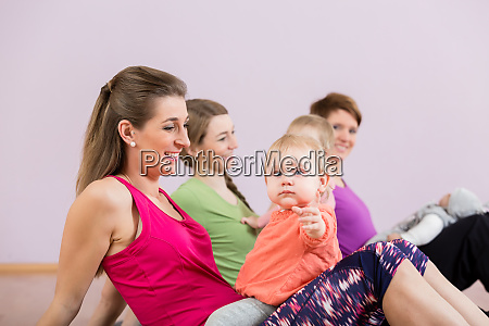 mothers exercising with babies at postnatal