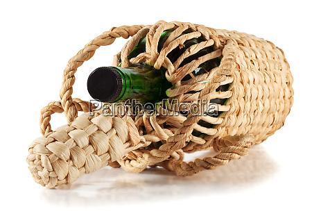green empty bottle in the braid