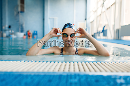 female swimmer in pool woman at