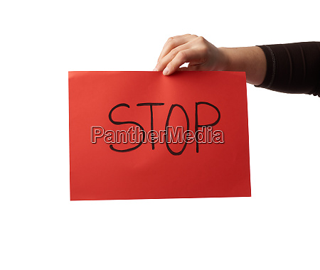 female hand holds a red sheet