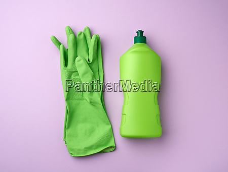 green plastic bottle with detergent for